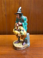 Sale 8313A - Lot 49 - A Royal Doulton figure, The Mask Seller, HN 2103, copyright 1952, height 22cm