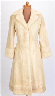 Sale 8640F - Lot 89 - A Berkeley of Burwood fur coat with matching fur hat.