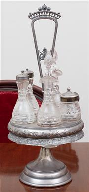 Sale 8908H - Lot 55 - A silver plate and glass centrepiece cruet with five bottles. Height 42cm
