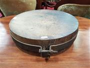 Sale 8925 - Lot 1083 - A timber chopping board with an iron strap surround