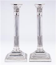 Sale 9015J - Lot 97 - A pair of large antique English silverplate corinthian columncandle sticks, C: 1890's, the reeded and fluted columns raised on a squ..