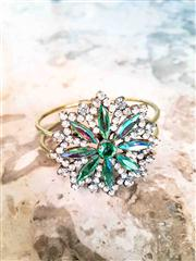 Sale 8577 - Lot 121 - A peridot green and diamante crystal flower bangle, Condition: Excellent