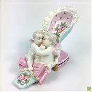 Sale 8652W - Lot 54 - Possibly Meissen Shoe Figural Group