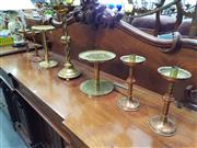 Sale 8693 - Lot 1029 - Three Various Brass Flower Stands & Set of Four candlesticks