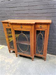 Sale 9014 - Lot 1047 - Victorian Inlaid Satinwood Breakfront Cabinet, in the Sheraton style, with cross-banded top, three drawers & three oval astragal pan...