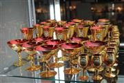 Sale 8269 - Lot 62 - Venetian Hand Painted Ruby Glass 24-Piece Drink Setting