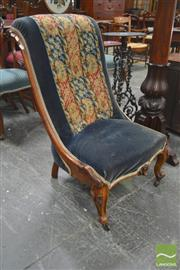 Sale 8267 - Lot 1003 - Victorian Carved Mahogany Slipper Chair, with rolled back upholstered in blue velvet & with original tapestry panel (distressed), on...