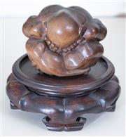 Sale 8800 - Lot 80 - A Japanese carved figure of a curled up man, with stand total height 10cm,