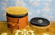Sale 8577 - Lot 122 - A vintage gentlemans grooming ebony Brush Kit Set  featuring two ebony brushes and a hard leather case, marked Real Ebony on both b...