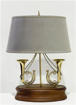 Sale 9162 - Lot 1034 - Antique Style Brass & Timber Table Lamp, the oval base with two miniature horns & grey fabric shade (h56 x d57cm)