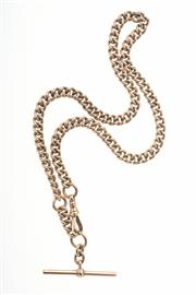 Sale 8315 - Lot 395 - AN ANTIQUE 9CT GOLD ALBERT CHAIN; stamped curb links with swivel clasp and T bar, length 40cm, wt. 36.9g.