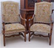 Sale 8550H - Lot 127 - A pair of antique French Henri II carved walnut framed arm chairs upholstered in original antique hand worked tapestry, H 124 x W 66cm