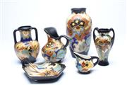 Sale 8701 - Lot 95 - Gouda Regina Jugs Vases And Tealight Holder