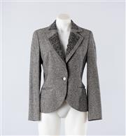 Sale 8760F - Lot 155 - An Escada textured jacket in a white and black silk/wool/cashmere blend, size 34