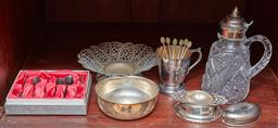 Sale 9098H - Lot 70 - A group lot of mainly silver pated wares including a syrup pourer, a tea strainer, bowls and spoons.