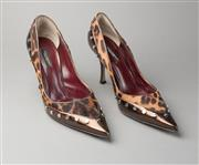 Sale 8499A - Lot 1 - A pair of Dolce et Gabbana leopard print fur and brown leather pumps with silvertone studwork and stiletto heels. Size: 38. Barely w...