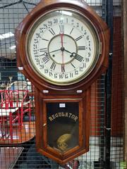 Sale 8576 - Lot 1012 - Late 19th/ Early 20th Century Ansonia Calendar Wall Clock, Regulator with red sweeping date hand