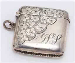 Sale 9180E - Lot 108 - An Edwardian sterling silver vesta with floral design and monogram to front, Birmingham, c.1905 by Smith & Bartlam, weight 22g