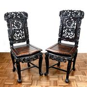 Sale 8000 - Lot 355 - A pair Chinese Republic Period carved rosewood side chairs with swirling dragons.