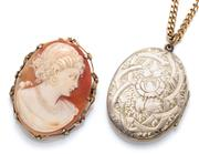 Sale 9029 - Lot 337 - A VINTAGE GILT LOCKET ON CHAIN AND CAMEO BROOCH; 41 x 33mm engraved locket on a curb chain together with a 40 x 30mm carved shell ca...