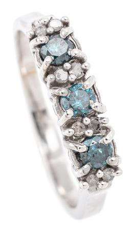 Sale 9128J - Lot 42 - A 10CT WHITE GOLD BLUE AND WHITE DIAMOND RING; set across the top with 3 round brilliant cut treated blue diamonds totalling approx....