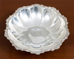 Sale 9140H - Lot 12 - A 925 silver scalloped bowl with floral rim and raised on tri-feet, Diameter 20cm, Weight 216g