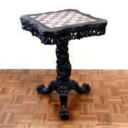 Sale 8000 - Lot 352 - An early 20th Chinese carved rosewood chess table on tripod base, with marble inlay and dragon pedestal.