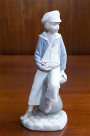 Sale 8313A - Lot 55 - A Lladro figure of a boy with a model yacht, height 23cm