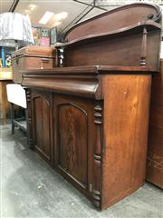 Sale 8774 - Lot 1056 - Victorian Mahogany Chiffonier, the carved back with small shelf, a single cushion drawer, above two panel doors & half columns