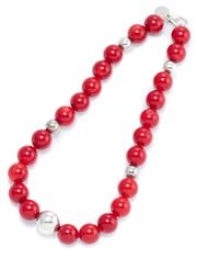 Sale 8965 - Lot 354 - A CORAL AND SILVER BEAD NECKLACE BY PAMELA DEAN; 13.5mm round red coral beads to silver hollow beads and parrot clasp, length 40cm.