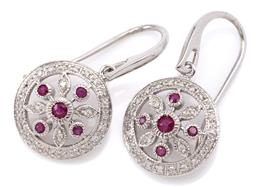 Sale 9132 - Lot 414 - A PAIR OF 9CT WHITE GOLD RUBY AND DIAMOND EARRINGS; each a 13mm wide pierced disc centring a floral cluster of round cut rubies and...
