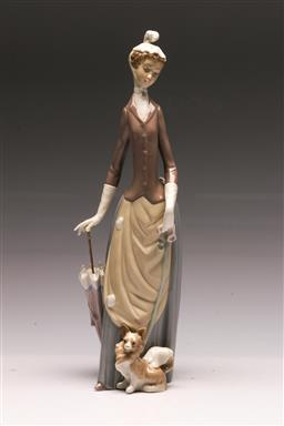 Sale 9138 - Lot 128 - A Lladro Figure of a Woman and Dog (H:36cm)