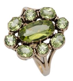 Sale 9209J - Lot 369 - A GEORGIAN STYLE PERIDOT CLUSTER RING; centring an oval cut peridot surrounded by round and oval cut peridots to split shoulders in...