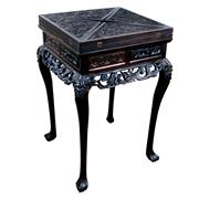 Sale 8000 - Lot 264 - An early 20th century Chinese rosewood games table with dragon carved envelope top and drawers below.