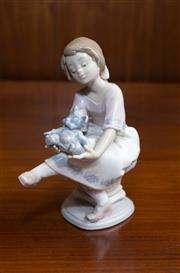 Sale 8313A - Lot 56 - A Lladro figure of a young girl with a teddy bear, teddy loose but repairable, incised 7620, height 16cm, Collectors Society piece...