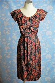 Sale 8577 - Lot 126 - A vintage 1950s raw silk floral wiggle dress by Miss Brooks New York featuring a striking black, orange and rust floral pattern,...