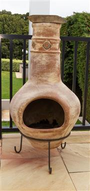 Sale 8677A - Lot 12 - A Terracotta chiminea on metal stand, Height 112cm