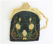 Sale 8928 - Lot 339 - AN ART NOUVEAU BEADED BAG; depicting flowers with B to reverse side (some missing beads), with pelican form celluloid kiss clasp and...