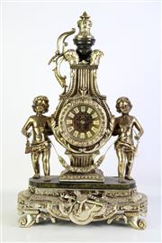 Sale 8905S - Lot 654 - A modern reproduction of an elaborate mantle clock with cherubs , possibly German. Height 58cm