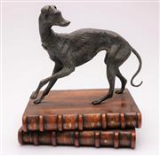 Sale 9044 - Lot 19 - Bronze Greyhound On Metal Book form Base (H:25cm W: 20cm D:24cm)
