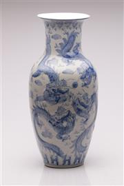 Sale 9057 - Lot 93 - Large blue and white Chinese dragon themed vase, chip/repair to rim (H47.5cm)