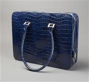 Sale 8499A - Lot 37 - An Aspinal of London large midnight blue crocodile bag with lined compartments and silvered hardware. Size: 32.5 x 41.5 cm x 11 cm.