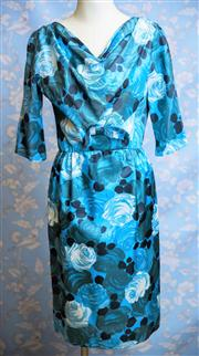 Sale 8577 - Lot 127 - A 1940s vintage rayon blue roses dress by Green Seal Model featuring large cabbage rose print, cowl neckline, 3/4 sleeves, bow de...