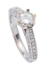 Sale 8999 - Lot 382 - AN 18CT WHITE GOLD DIAMOND RING; claw set with a round brilliant cut diamond of approx. 0.50ct, P1, to shoulders sides and gallery f...