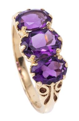 Sale 9209J - Lot 375 - A VICTORIAN STYLE 9CT GOLD AMETHYST RING; claw set across the top with 3 graduated oval cut amethysts, size N, 1/2, top 8.7 x 16mm,...