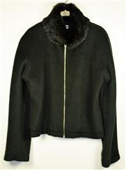 Sale 8460F - Lot 19 - A Moschino Jeans black rabbit fur collared zippered jacket, USA size 12