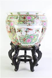 Sale 8905S - Lot 656 - A large famile rose jardiniere on timber stand. Height of Jardiniere 32cm x Diameter 37cm