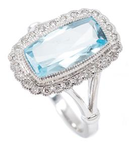 Sale 9209J - Lot 399 - A 9CT WHITE GOLD TOPAZ AND DIAMOND RING; set with a long rectangular cushion cut blue topaz of approx. 3.43ct to scalloped surround...