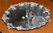 Sale 8015A - Lot 83 - A large highly embossed tri-footed silver plated salver in the Rococo taste