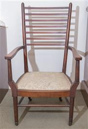 Sale 8440A - Lot 23 - A mahogany ladder back chair on cushioned seat raised on castors, H of seat 34cm H of back 96cm
